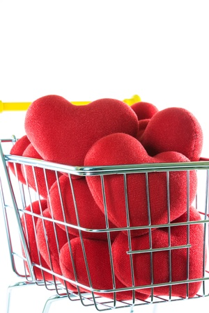 Many red hearts in shopping cart concept  Stock Photo - 17502402