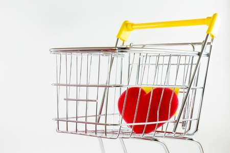 One red heart in shopping cart Stock Photo - 17502397