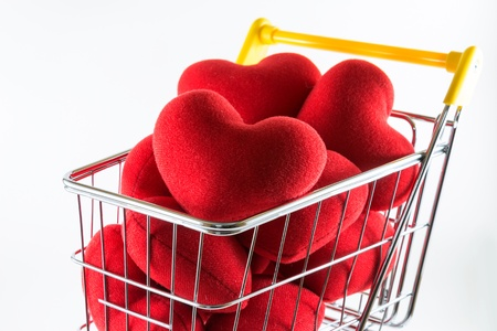 Closeup many red hearts in shopping cart Stock Photo - 17502399
