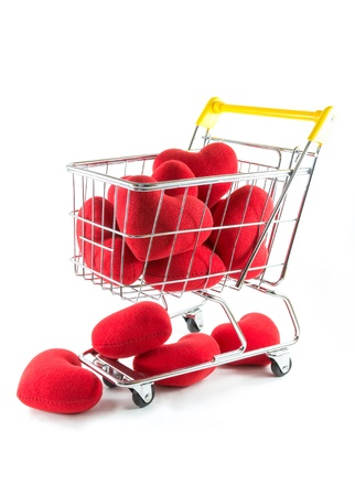 Many red hearts in shopping cart and fall on the floor Stock Photo - 17545724