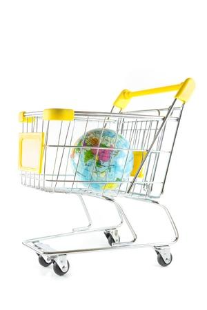 Globe model in shopping cart on white background Stock Photo - 17502398