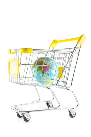 Globe model in shopping cart on white background Stock Photo - 17502398