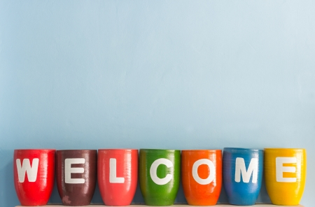 Welcome word on vase background blue sky wall