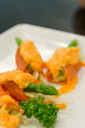Salmon with eggs prawn sauce on white plate  Stock Photo