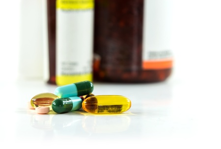 Closeup group of pills and bottle background  Stock Photo