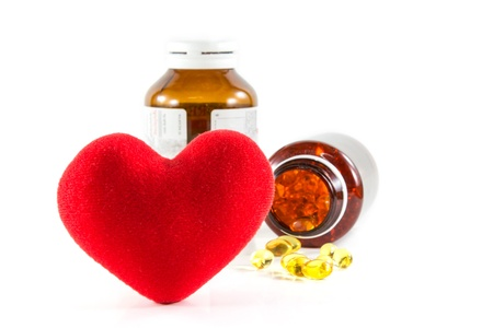Heart shape and pills with bottles  photo