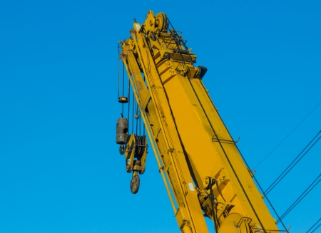maneuverable: Yellow crane on construction site