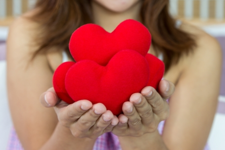 Closeup women happiness with many heart shape in hands  photo