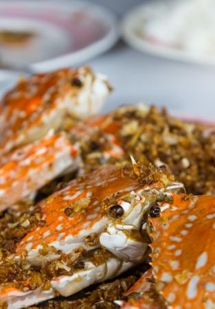 Set menu fried crabs with garlic and rice closeup