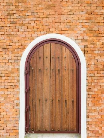 Old style wooden door on wall brick in vertical