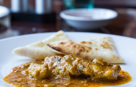 Closeup flat bread with chicken massaman curry sauce Stock Photo