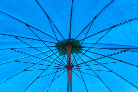 Inside of the big umbrella Stock Photo