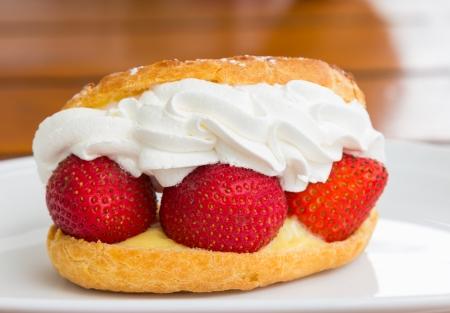 Strawberry cream with bread closeup