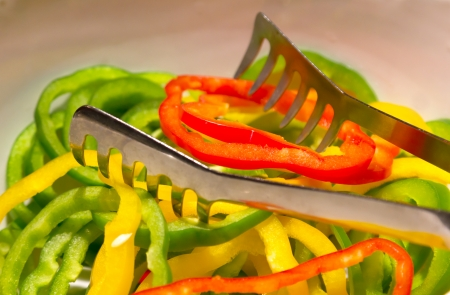Closeup slices of bell pepper in dish  Stock Photo