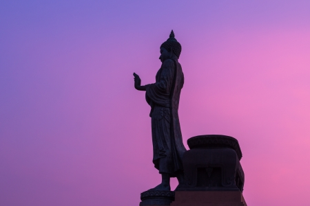 Buddha statue on twilight sky photo