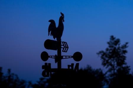 wheather: Silhouette wheather vane at dawn  Stock Photo