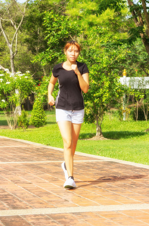 Young women with step exercise by jogging
