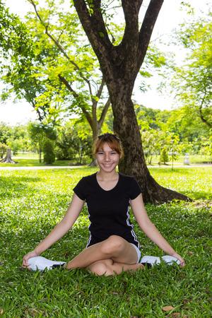 Young women happiness yoga with cross legged  Stock Photo