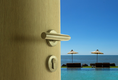 The door open to sea view in blue sky  photo