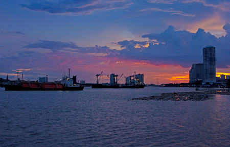 Industry ship with cargo on the river sunset sky  Stock Photo