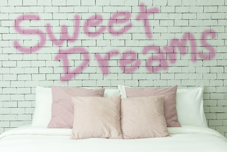 Sweet dreams word on white bricks wall background