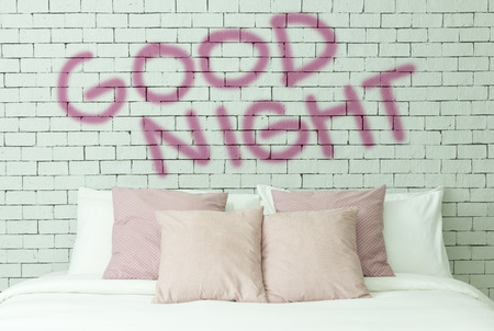 Good night word on white bricks wall background
