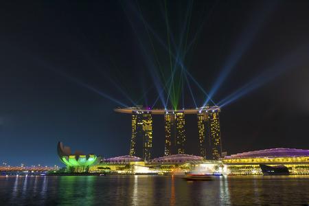 Marina Bay, Singapore - October 23, 2014: Across Marina Bay Sands Hotel during an evening light of the wonderful show.