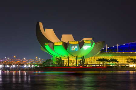 Marina Bay, Singapore - October 23, 2014: view of the ArtScience Museum at Marina Bay Sands, Singapore. ArtScience Museum is designed by Moshe Safdie. It become a famous tourist attractions in Singapore. Editorial
