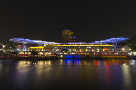 Clarke quay, Singapore - October 25, 2014: Famous place night life pub and restaurant with historical riverside quay in Singapore. Editorial