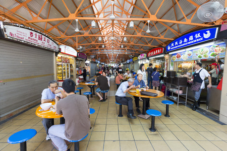 singapore culture: Chinatown, Singapore - October 26, 2014: Maxwell food center is a local food court in chinatown and popular for tourist.