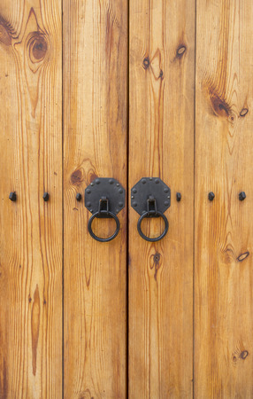 Wooden gate with door knocker chinese style vertical Stock Photo
