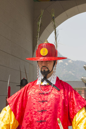 koreans: Seoul, South Korea - April 11, 2015: Koreans in Traditional Costumes on duty of the Royal Guard Ceremony at Gyeongbokgung Palace