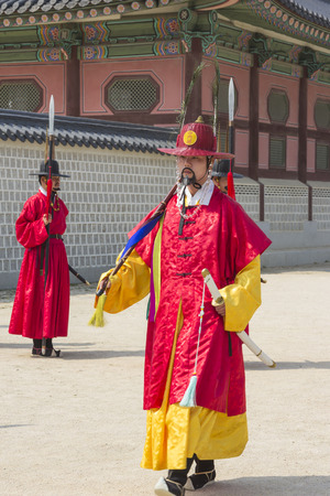 koreans: Seoul, South Korea - April 11, 2015: Koreans in Traditional Costumes Performing practice of the Royal Guard Ceremony at Gyeongbokgung Palace