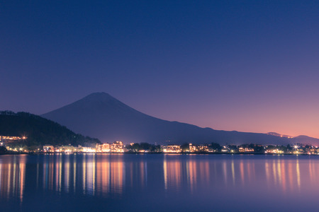 Night scene of Mt fuji and the city around kawaguchi lake, japan