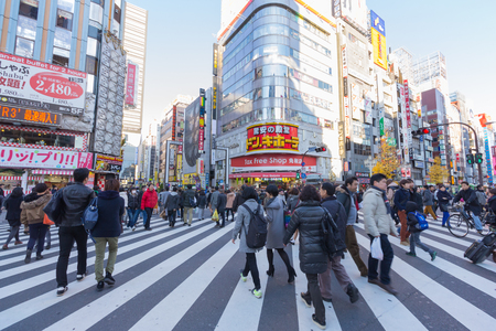 Shinjuku, Tokyo - Dec 30 : Street life in Shinjuku on Dec 30, 2015. Shinjuku is a special ward located in Tokyo Metropolis, Japan. It is a major commercial and administrative center.