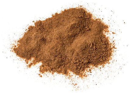Cinnamon powder isolated on white background,macro shot