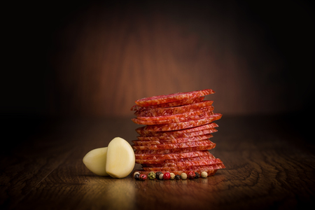 Slices of salami  on a wooden table