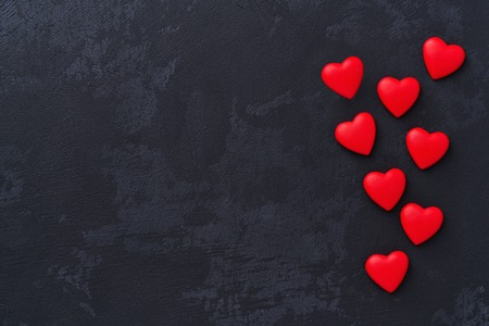 valentines day background red hearts on on black background