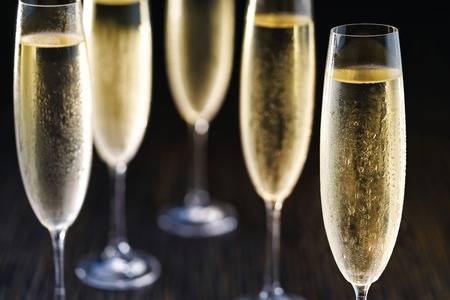 Cold glasses of champagne on black background.Selective focus. Stock Photo