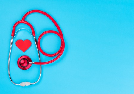 Medical equipment: red stethoscope on blue background.World health day.Medicine concept. Stock Photo