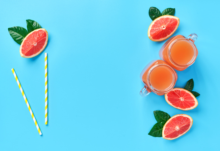 Fresh grapefruit juice on a blue background,top view