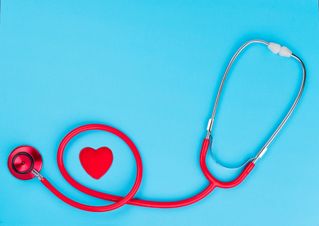 Red stethoscope or phonendoscope  on blue table background with copy space for  text. Medicine concept Banque d'images