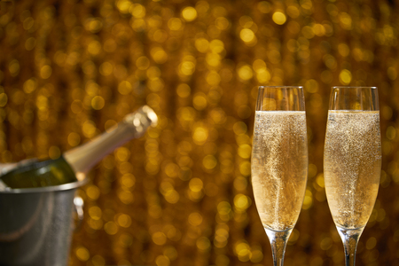 Two glasses of champagne on abstract  bokeh background