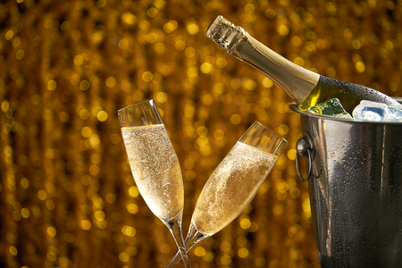 New Year Toast champagne on golden bokeh background Banco de Imagens