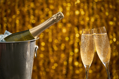 Two glasses of champagne with lights in the background., very shallow depth of field Banco de Imagens