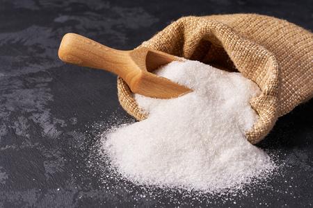 powdered white sugar  in bag on black background