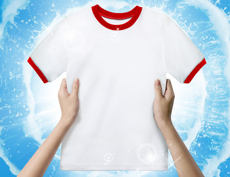 Hands holding a white clean shirt  photo
