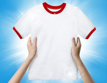 Hands holding a white clean shirt Stock Photo - 26240778