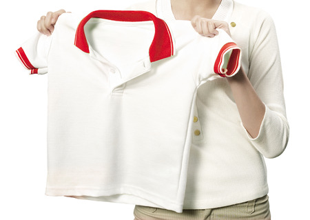 Hands holding a white clean shirt Stock Photo - 26240785