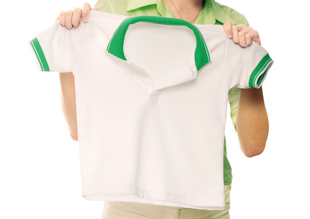 Hands holding a white clean shirt